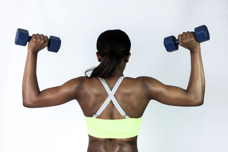 Fitness woman holding dumbbells up