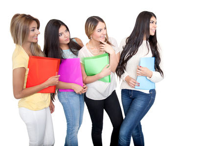 Group of beautiful female students looking at something