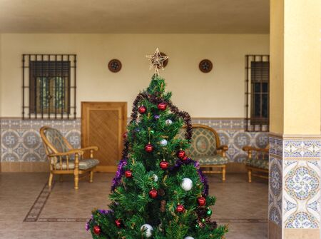 lawn chair: An artificial christmas tree in the middle of the patio in december Stock Photo