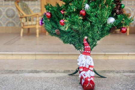patio: Santa claus next to christmas tree in a patio