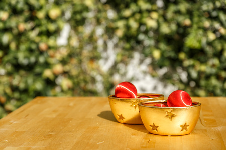 Red Christmas Balls And Yellow Decorative Bowls On A Wooden Table New Decorative Bowls And Balls