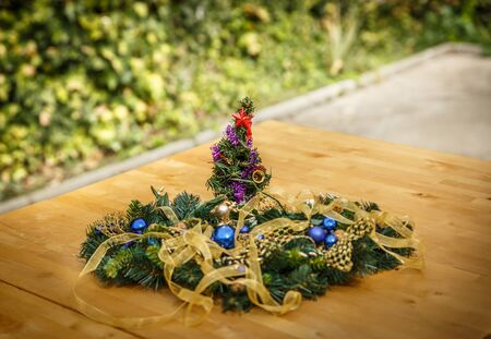 Typical decorative Christmas ornaments, on a wooden table in a patio