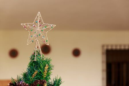 Pretty and simple christmas star on top of a Christmas tree