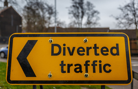 Traffic sign on yellow background on a street in england, UK Stock Photo