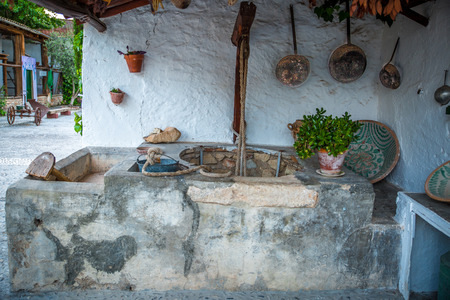 cesspool: Old well located in a large yard of a typical house in Granada, Spain