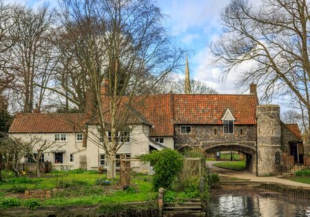 english house: View of a beautiful and large English house, situated at the edge of a river, in Norwich. UK Stock Photo