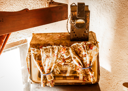 Ancient radio lined with cloth, in a corner of an old house Stock Photo