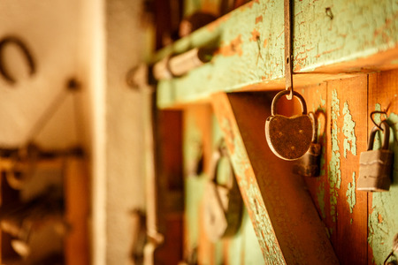 secondhand: Old padlocks placed on an old and decayed wooden door