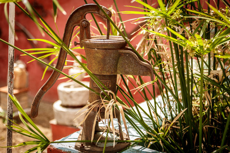 Close-up of an old and rusty metal water pump used decades ago Stock Photo