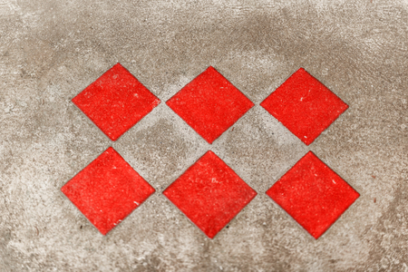 Group of six red textured rough tiles Stock Photo