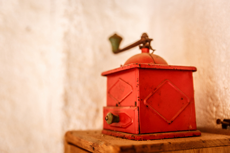 Old red metallic box with a white wall background Stock Photo
