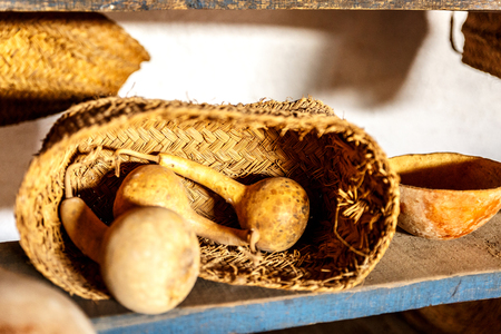 Wicker basket with dried vegetables on a wooden plank Stock Photo