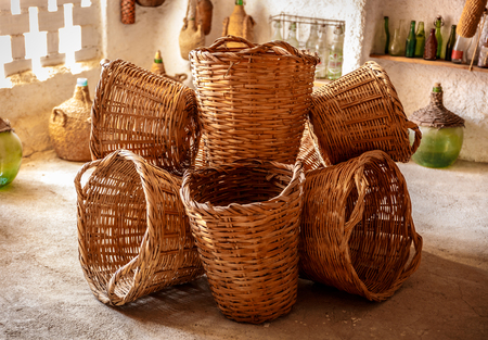Set of nice wicker baskets, arranged in an orderly manner Stock Photo