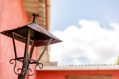 Old and rusty street lamp without light bulb and crystals Stock Photo