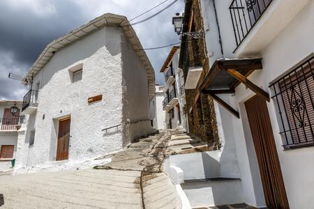 Quiet and steep street of Capileira in La Alpujarra, Granada, Spain
