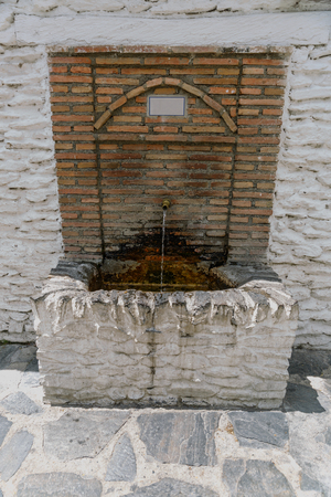 alpujarra: Beautiful fountain of bricks from a village, in southern Spain