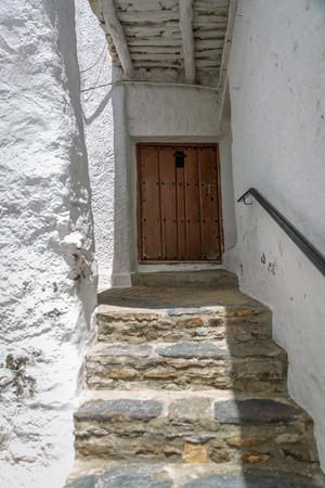 hick: View of  the main entrance of a rustic house, in La Alpujarra, Granada, Spain Stock Photo