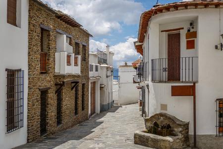 Beautiful view of a street in a village of La Alpujarra, Granada, Spain