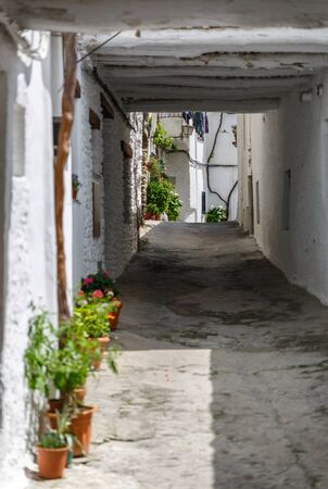 alpujarra: A narrow and beautiful street in a village of La Alpujarra, Granada, Spain Stock Photo
