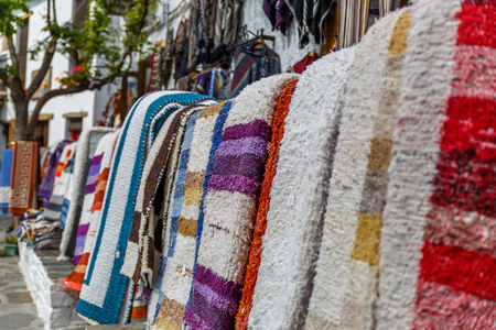 View of several rugs on the outside of a shop. in a village in the south of Spain Stock Photo