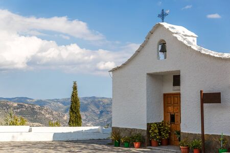 View of a small hermitage, on the edge of a road in southern Spain