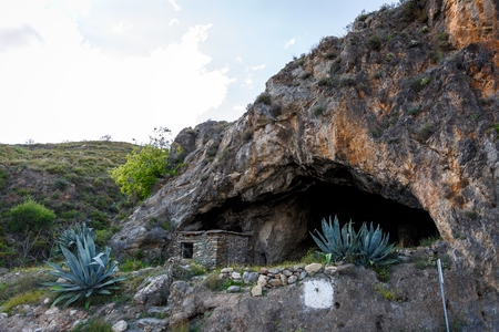 View of the entrance of a large stone cave