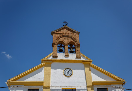 Top of a church in a town of Granada,  on a sunny and clear day