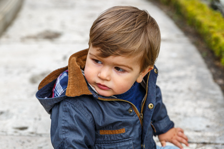A cute kid turns his head with concern