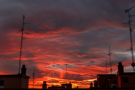 Stunning sunset over a city, rich in dark clouds and rays of light
