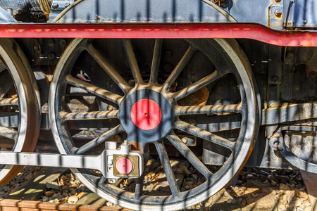 outworn: Close view of a wheel of a locomotive