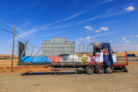 Awesome view of a colorful trailer of a truck, totally burned and abandoned Stock Photo