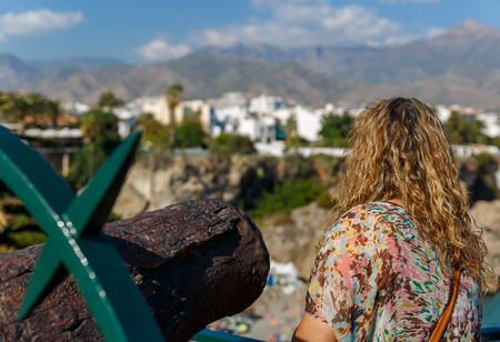nerja: A woman looks at the beautiful views of a Mediterranean landscape, on a beautiful summer day Stock Photo