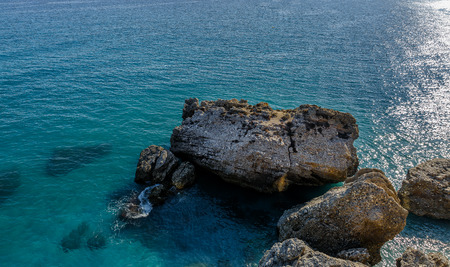 blue fish: Beautiful view of the mediterranean sea with a large rocks and near the shore Stock Photo