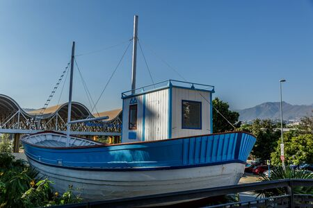 nerja: Beautiful boat of blue and white colors, in a sunny day Stock Photo