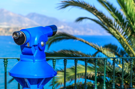 nerja: Spyglass, palm trees and beautiful landscape background on a summer day in Nerja, Malaga