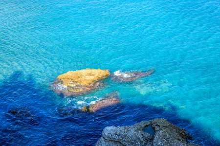 nerja: Beautiful view of the mediterranean sea in Nerja, with a large rocks and near the shore