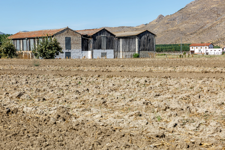 View of old huts and a very arid territory in the south of Spain Stock Photo