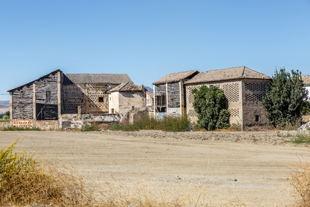 View of some cottages and cabins in the middle of an arid area in southern Spain