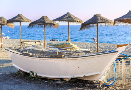 Close-up of a boat in the middle of a tropical climate beach, Spain