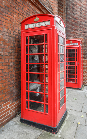 antique booth: Two typical telephone booths on a quiet London street, UK Stock Photo