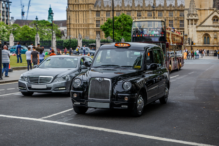 A typical London street with an English taxi, near Westminster Palace, United Kingdom