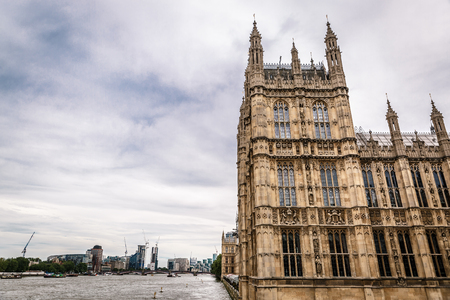 old town guildhall: Westminster Palace (Houses of Parliament) on the side by the River Thames, London. United Kingdom Stock Photo