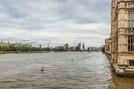 old town guildhall: View of the River Thames next to the Palace of Westminster, London, United Kingdom