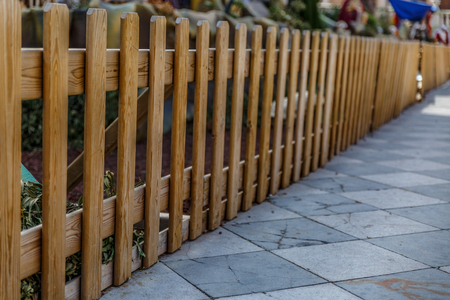Wooden fence surrounding a large manger