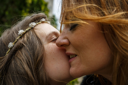 Mother and daughter have a very affectionate gesture of approach