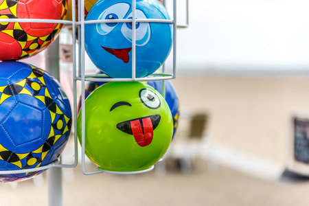 Set of colored balls to play on the beach, exposed for sale