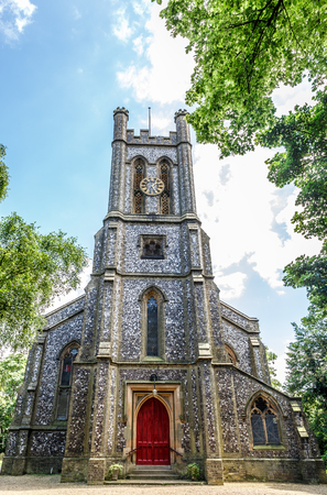 Facade of a typical English church surrounded by greenery, UK