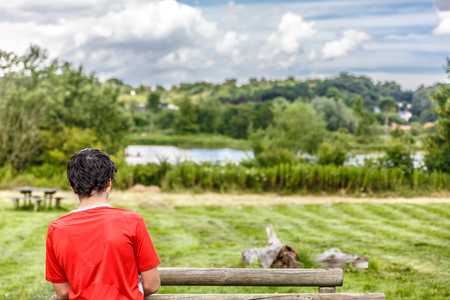 A boy contemplates a beautiful and tranquil natural landscape of Norwich, UK Banco de Imagens