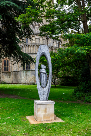 Curious sculpture on the grass near a cathedral in the city of Norwich, UK Stock Photo