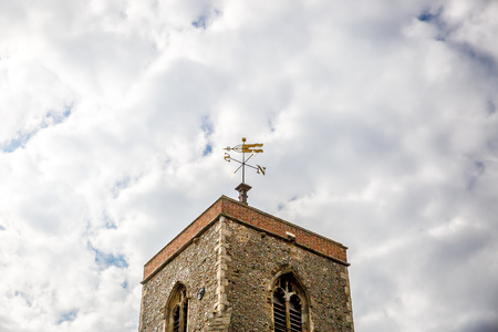 Typical tower of a church in England, with the sky in the background, UK Stock Photo